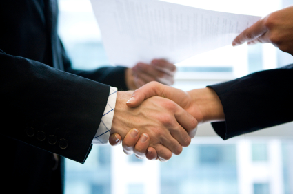 people shaking hands and share document
