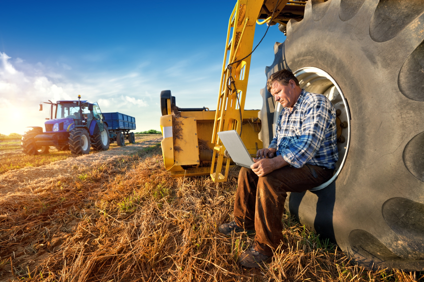man sit on tractor in field